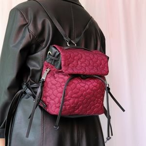 Small black & purple/mauve quilted backpack
